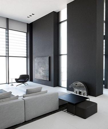 El gris carbón intenso y profundo se combina con el blanco para una decoración luminosa y contemporánea.  Pintado en dos secciones de la pared, da relieve a una sala de estar de diseño.