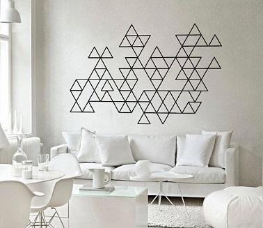 Use cinta adhesiva para decorar una pared con formas gráficas, una idea de decoración inteligente y económica.  ¡Dibuja un plan de antemano y pégalo!
