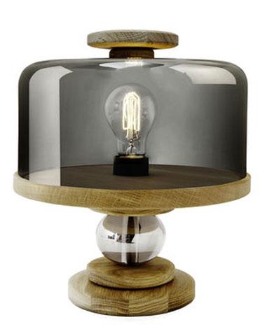 Inspirada en una campana de pastel, esta lámpara de mesa para la sala de estar tiene un potencial único de originalidad