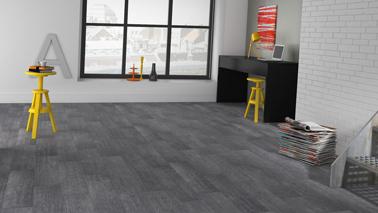 Imitación farol de un suelo de hormigón estilo loft con este suelo de PVC tiras autoadhesivas de color gris hormigón en Saint Maclou